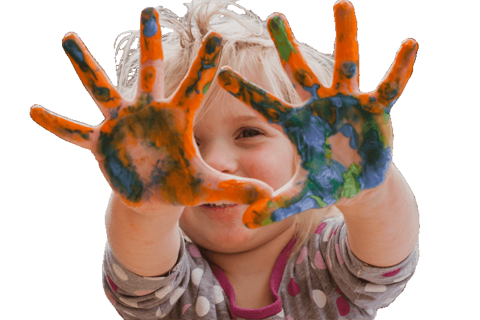 Boy playing with painted hands
