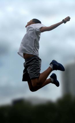 Boy jumping with joy